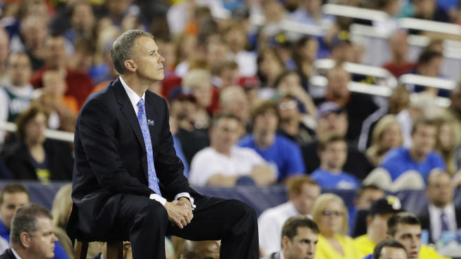 Florida Gulf Coast head coach Andy Enfield watches action against Florida during the second half of a regional semifinal game in the NCAA college basketball tournament, Saturday, March 30, 2013, in Arlington, Texas. (AP Photo/Tony Gutierrez)