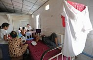 A patient lies on a bed at a charity-run clinic in Yangon. Under the junta, NGOs were banned from public hospitals and ran a parallel health service, but now they are calling for closer cooperation with the government to extend the reach of healthcare