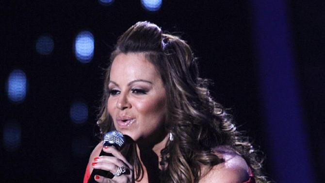 FILE - In this April 26, 2012 file photo, singing superstar Jenni Rivera performs during the Latin Billboard Awards in Coral Gables, Fla. Some final words from the late Mexican-American singer and TV star Jenni Rivera will be out this summer. Atria Books announced Monday, Feb. 18, 2013 it's publishing a memoir by the multimillion-selling artist, who died in a plane crash in December at age 43. (AP Photo/Lynne Sladky, File)