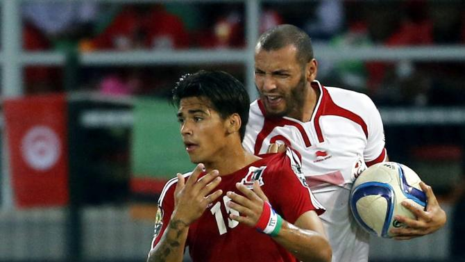 Yassine Chikhaoui of Tunisia argues with Equatorial Guinea's Ivan Edu during quarter-final soccer match of the 2015 African Cup of Nations in Bata