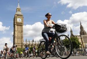 File photograph of cyclists riding past the Houses of Parliament during the Prudential RideLondon FreeCycle ride in central London