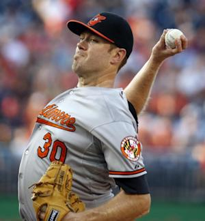 Orioles score 6 in 11th to beat Nationals 8-2