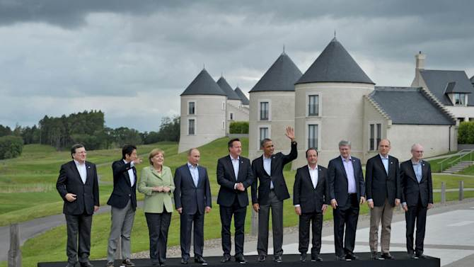 G-8 leaders from left, European Commission President Jose Manuel Barroso, Japan's Prime Minister Shinzo Abe, German Chancellor Angela Merkel, British Prime Minister David Cameron, US President Barack Obama, Russian President Vladimir Putin, French President Francois Hollande, Canadian Prime Minister Stephen Harper, Italian Prime Minister Enrico Letta and European Council President Herman Van Rompuy walk to a group photo opportunity during the G-8 summit at the Lough Erne golf resort in Enniskillen, Northern Ireland, on Tuesday, June 18, 2013. The final day of the G-8 summit of wealthy nations is ending with discussions on globe-trotting corporate tax dodgers, a lunch with leaders from Africa, and suspense over whether Russia and Western leaders can avoid diplomatic fireworks over their deadlock on Syria?s civil war. (AP Photo/RIA-Novosti, Alexei Nikolsky, Presidential Press Service)