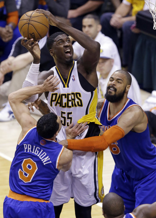 Indiana Pacers center Roy Hibbert (55) is fouled by New York Knicks center Tyson Chandler, right, as he shoots in front of Knicks guard Pablo Prigioni during the third quarter of Game 6 of the Eastern
