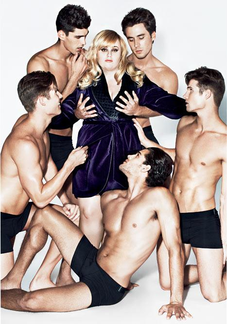 PICTURE: Rebel Wilson Surrounds Herself With Hunky, Half-Naked Men