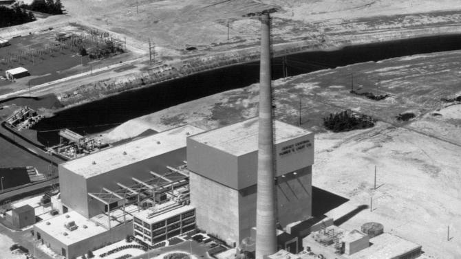 """FILE - This July 12, 1972 file picture shows the Oyster Creek nuclear power plant in Lacey Township, N.J. Called """"Oyster Creak"""" by some critics because of its aging problems, this boiling water reactor began running in 1969 and ranks as the country's oldest operating commercial nuclear power plant. Its license was extended in 2009 until 2029, though utility officials announced in December 2010 that they'll shut the reactor 10 years earlier, rather than build state-ordered cooling towers. (AP Photo)"""