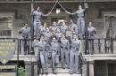This undated image taken from Twitter shows 16 black, female cadets in uniform with their fists raised while posing for a photograph at the United States Military Academy at West Point, N.Y. The U.S. Military Academy has launched an inquiry into the photo. The image has spurred questions about whether the gesture violates military restrictions on political activity. Spokesman Lt. Col. Christopher Kasker said Saturday, May 7, 2016 that West Point is looking into whether any rules were broken. ( Photo take from Twitter via AP)
