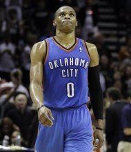 Oklahoma City Thunder point guard Russell Westbrook reacts against the San Antonio Spurs during the second half of Game 2 in their NBA basketball Western Conference finals playoff series, Tuesday, May 29, 2012, in San Antonio. The Spurs won 120-111. (AP Photo/Eric Gay)