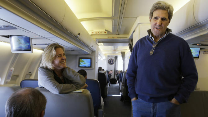 U.S. Secretary of State John Kerry, center, visits with the traveling media aboard a plane en route to London on his inaugural trip as secretary on Sunday, Feb. 24, 2013. (AP Photo/Jacquelyn Martin, Pool)