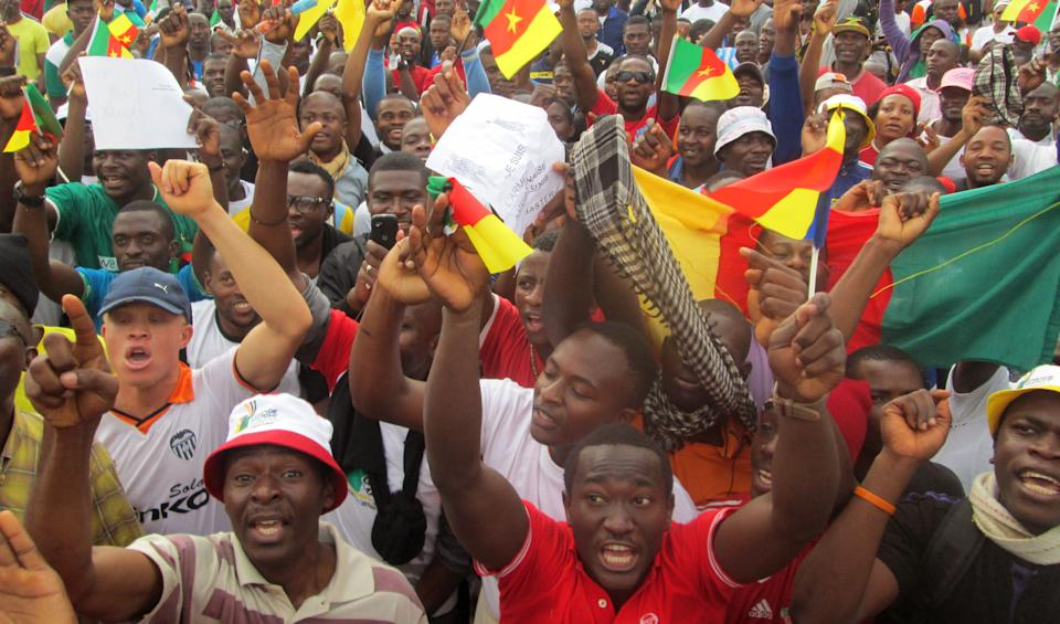 Cameroonian people gather to protest against Islamic extremists attacks in Yaounde, Cameroon, Saturday, Feb. 28, 2015.  Some thousands of Cameroonian ...