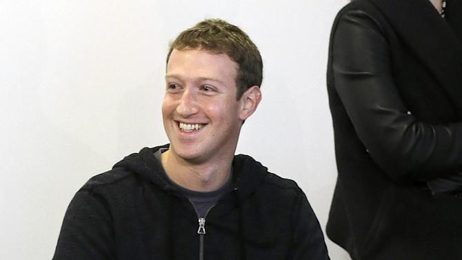 "Facebook CEO Mark Zuckerberg smiles after speaking at Facebook headquarters in Menlo Park, Calif., Tuesday, Jan. 15, 2013. Zuckerberg introduced ""graph search"" Tuesday, a new service that lets users search their social connections for information about their friends' interests, and for photos and places.  (AP Photo/Jeff Chiu)"