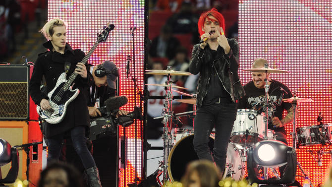 """FILE - In this Oct. 31, 2010 file photo, My Chemical Romance performs during the pre-game show for the NFL Football game between the Denver Broncos and San Francisco 49ers at Wembley Stadium in London.  The New Jersey-based band announced early Saturday, March 23, 2013,  that """"it has come time for it to end."""" The foursome thanked their fans in a statement and said the experience was """"a true blessing."""" My Chemical Romance's sound is a mix of alternative, punk rock and pop. They released their debut album in 2002, but really made a splash on the music scene in 2004 with the platinum-selling """"Three Cheers for Sweet Revenge."""" It featured the Top 40 hit """"Helena."""" (AP Photo/Tom Hevezi)"""