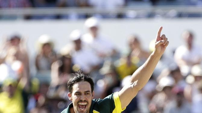 Australia's Mitchell Johnson celebrates after taking the wicket of England's James Taylor during their One Day International tri-series cricket final match at the WACA ground