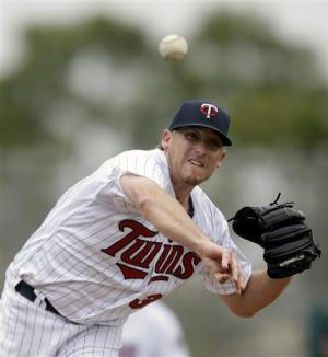 Revere excels against former team, Twins top Phils