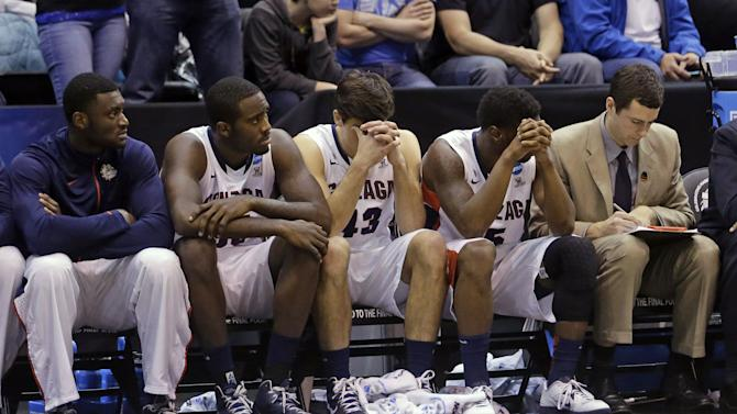 Members of the Gonzaga bench lower their heads near the end of their game against Wichita State during a third-round game in the NCAA college basketball tournament in Salt Lake City Saturday, March 23, 2013. Wichita State defeated Gonzaga 76-70. (AP Photo/Rick Bowmer)