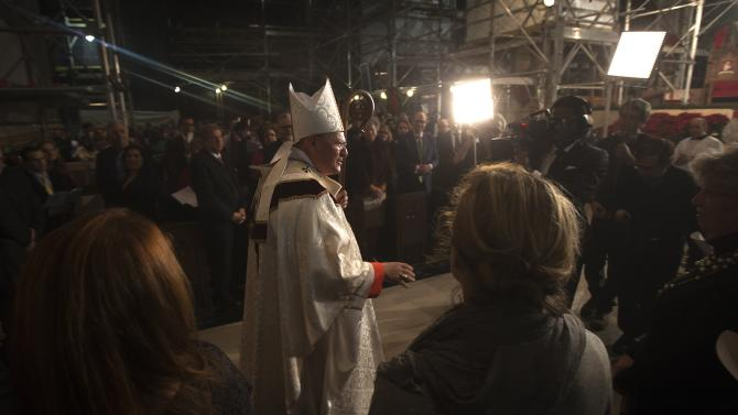 Cardinal Dolan arrives for a midnight mass at St Patrick's Cathedral in the Manhattan borough of New York
