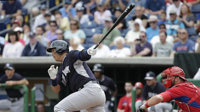 New York Yankees designated hitter Alex Rodriguez hits a second-inning single in a spring training baseball game against the Philadelphia Phillies in Clearwater, Fla., Friday, March 27, 2015. (AP Photo/Kathy Willens)