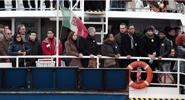 Relatives of the 32 victims of the Costa Concordia shipwreck, aboard a ferry approach the ship off the Tuscan Island Isola del Giglio, Italy, Sunday, Jan. 13, 2013. Survivors of the Costa Concordia sh