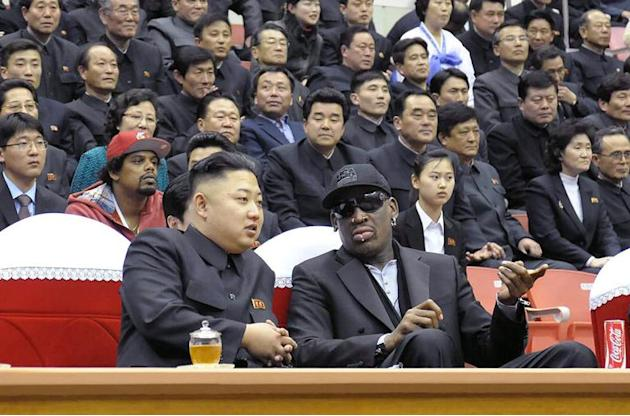A photo released by North Korea's official Korean Central News Agency (KCNA) shows North Korean leader Kim Jong-Un (front L) and former NBA star Dennis Rodman (front R) at a basketball game, in Py