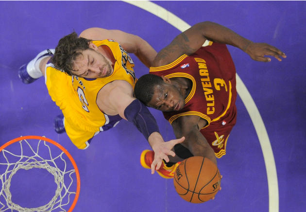 Cleveland Cavaliers guard Dion Waiters, right, puts up a shot as Los Angeles Lakers center Pau Gasol, of Spain, defends during the second half of an NBA basketball game, Tuesday, Jan. 14, 2014, in Los