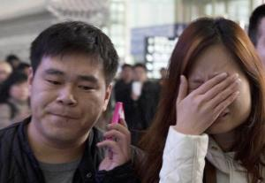 ALTERNATE CROP OF XHG102 A woman cries at the arrival…