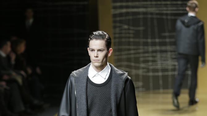 A model wears a creation of Ermenegildo Zegna men's Fall-Winter 2013-14 collection, part of the Milan Fashion Week, unveiled in Milan, Italy, Saturday, Jan. 12, 2013. (AP Photo/Antonio Calanni)