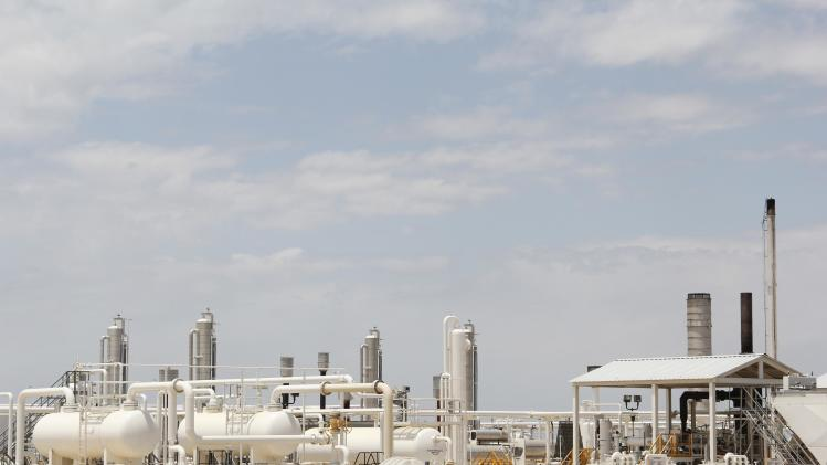 File photo of an oil and gas processing plant fed by local shale wells pictured along a highway outside Carrizo Springs