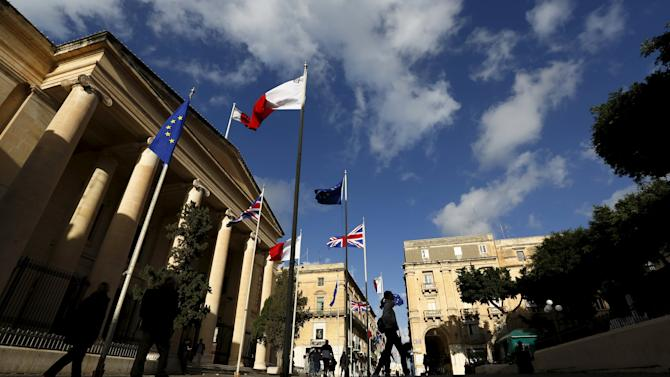 British, Maltese and European Union flags adorn a street to celebrate the upcoming Commonwealth Heads of Government Meeting (CHOGM) and visit to Malta by Britain's Queen Elizabeth II in Valletta
