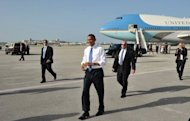 <p>US President Barack Obama walks across the tarmac to greet well-wishers upon arrival at West Palm Beach International Airport July 19, in West Palm Beach, Florida. Obama warned of cyber threats to critical US infrastructure and called on Congress to take action in an op-ed published Friday in the Wall Street Journal.</p>