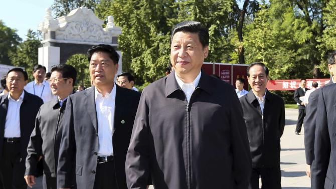 In this photo released by Xinhua News Agency, Chinese Vice President Xi Jinping, center, attends an activity to mark this year's National Science Popularization Day at China Agricultural University in Beijing, Sunday, Sept. 15, 2012. China's presumed next leader Xi made an appearance Saturday for the first time since dropping from public view earlier this month, a two-week absence that fueled rumors about his health and raised questions about the stability of the country's succession process. (AP Photo/Xinhua, Lan Hongguang) NO SALES