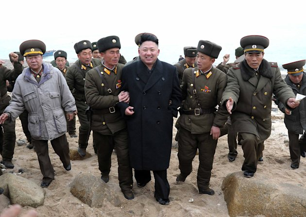 In this March 7, 2013 photo released by the Korean Central News Agency (KCNA) and distributed March 8, 2013 by the Korea News Service, North Korean leader Kim Jong Un, center, walks with military pers