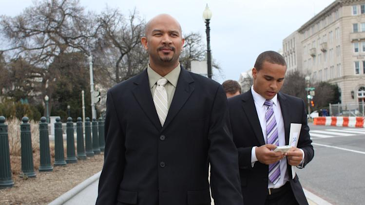 FILE - In this April, 2, 2014 file photo, former Northwestern football quarterback Kain Colter, right, and Ramogi Huma, founder and president of the National College Players Association, arrive on Capitol Hill in Washington. Northwestern football players will cast secret ballots Friday, April 25, 2014, on whether to form the nation's first union for college athletes, a potentially landmark vote that will, however, be kept sealed for weeks or months, and possibly years. Colter announced in January that he would lead the drive to unionize. The CAPA would represent the players at the bargaining table if the pro-union side prevails. (AP Photo/Lauren Victoria Burke, File)