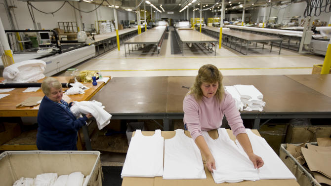 FILE - In this Monday, Oct. 15, 2012 file photo, Judy Dross, left, and Gloria Bambrick count and stack components of T-shirts at FesslerUSA apparel manufacture in Orwigsburg, Pa. Superstorm Sandy depressed U.S. industrial output in October, while production of machinery and equipment declined sharply, reflecting a more cautious outlook among businesses, according to Federal Reserve reports, Friday, Nov. 16, 2012. (AP Photo/Matt Rourke, File)