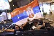 Supporters of Serbia's newly elected president and leader of Serbian Progressive Party (SNS), Tomislav Nikolic, celebrate his victory in the Serbian presidential run-off, in downtown Belgrade on May 20, 2012