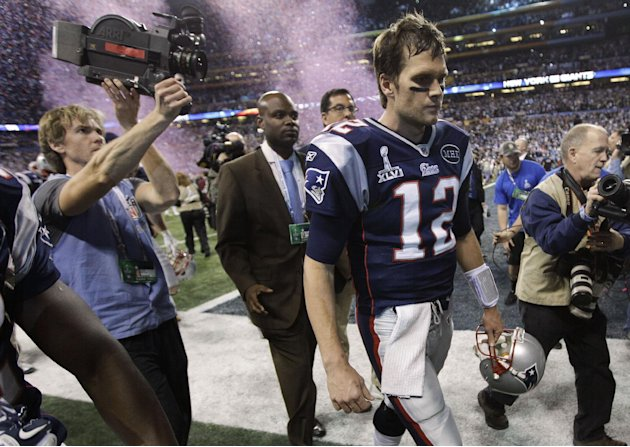 Feb. 5 New England Patriots quarterback Tom Brady walks off the field after the Patriots' 21-17 loss to the New York Giants in the NFL Super Bowl XLVI football game, Sunday, Feb. 5, 2012, in India