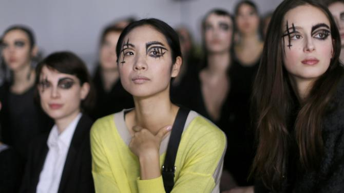 Models wait before Japanese designer Yohji Yamamoto's Autumn/Winter 2015/2016 women's ready-to-wear collection during Paris Fashion Week