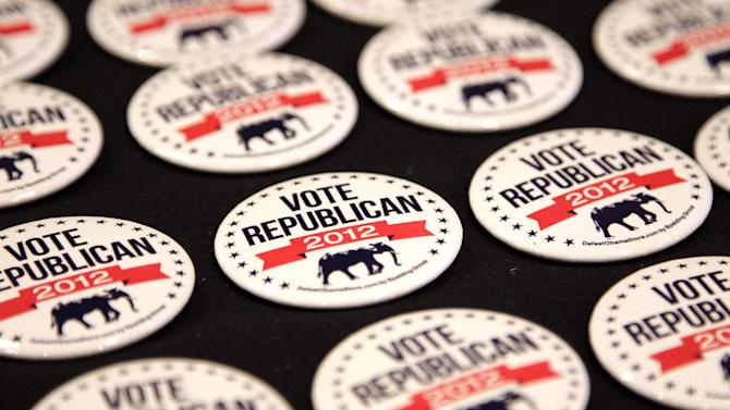 Campaign buttons are displayed at the RNC State Chairman's National Meeting in Scottsdale, Ariz., Friday, April 20, 2012. Republican presidential candidate, former Massachusetts Gov. Mitt Romney is scheduled to speak at the meeting. (AP Photo/Jae C. Hong)