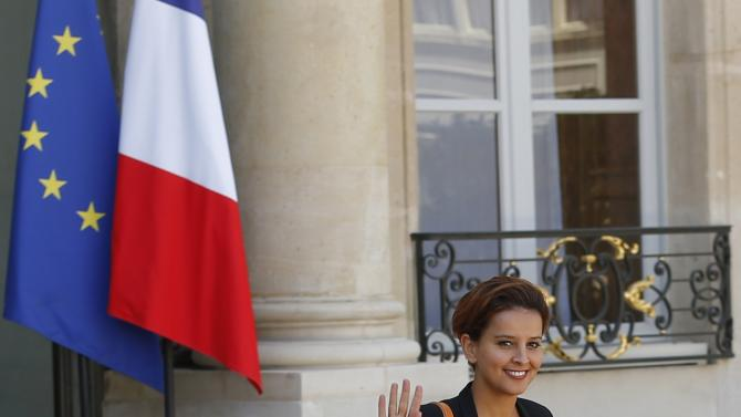 French Education Minister Najat Vallaud-Belkacem walks as she leaves the Elysee Palace following the weekly cabinet meeting in Paris