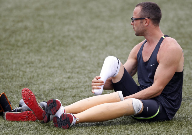 Pistorius of South Africa removes his prosthetic legs before wearing his running blades during a training session for the IAAF Daegu 2011 World Championship