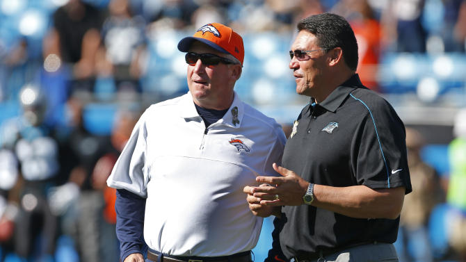 Denver Broncos head coach John Fox, left, talks with Carolina Panthers head coach Ron Rivera, right, before an NFL football game in Charlotte, N.C., Sunday, Nov. 11, 2012. (AP Photo/Bob Leverone)