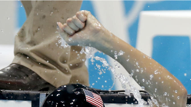 FILE - In this July 31, 2012, file photo, United States' Allison Schmitt celebrates her gold medal win in the women's 200-meter freestyle swimming final at the Aquatics Centre in the Olympic Park during the 2012 Summer Olympics in London. One week, you're basking in the glory, five medals around your neck. The next, you're adjusting to the rigors of studying and exams. For Schmitt, one of the top U.S. athletes at the London Games, it's back to school. (AP Photo/Daniel Ochoa De Olza, File)