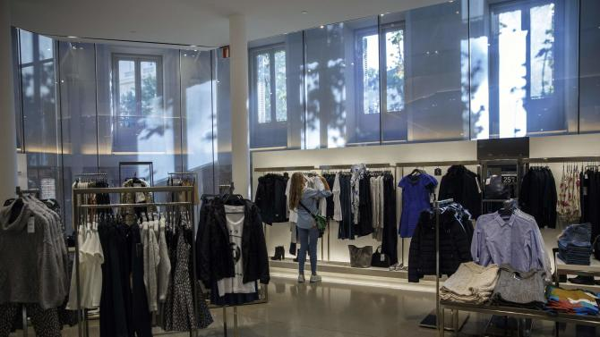 Woman looks at clothes inside a Zara store in Madrid