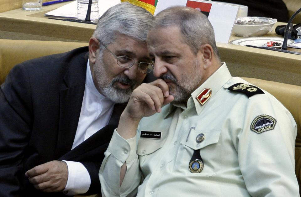 Iran's envoy to the International Atomic Energy Agency, IAEA, Ali Asghar Soltanieh, left, talks with Iran's police chief Esmail Ahmadi Moghaddam, at the Nonaligned Movement summit, in Tehran, Iran, Friday, Aug. 31, 2012. (AP Photo/Vahid Salemi)