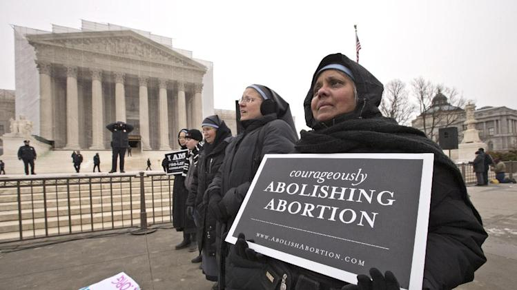Sisters from the Disciples of the Lord Jesus Christ Franciscan community in  Prayer Town, Texas, near Amarillo, join anti-abortion activists at the Supreme Court in Washington, Friday, Jan. 25, 2013, as they observe the 40th anniversary of the Roe v. Wade decision. Thousands of anti-abortion demonstrators marched through Washington to the steps of the U.S. Supreme Court to protest the landmark decision that legalized abortion. (AP Photo/J. Scott Applewhite)