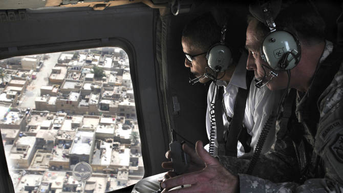 FILE - In this July 21, 2008 file photo, then-presidential candidate Barack Obama, left, and then-top U.S. military commander in Iraq, David Petraeus, take a helicopter ride over Baghdad's Shiite enclave of Sadr City, Iraq. Petraeus, the retired four-star general who led the U.S. military campaigns in Iraq and Afghanistan, resigned Friday, Nov. 9, 2012 as director of the CIA after admitting he had an extramarital affair. (AP Photo/Ssg. Lorie Jewell, Pool, File)