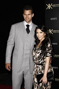Kim Kardashian and Kris Humphries, NBA basketball player, at the Kardashian Kollection launch party in Montecito, Calif., days before their reality TV mega-wedding in August. Less than 75 days later, divorce papers are filed. (AP Photo/Matt Sayles)