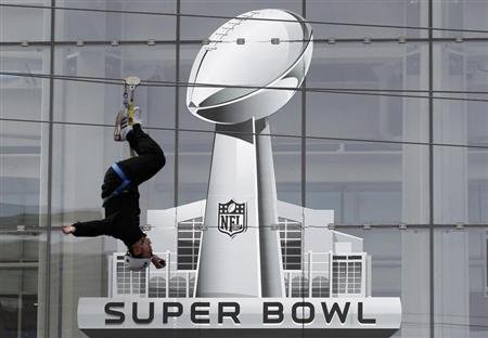 A fan rides a zip line as part of the Super Bowl XLVI festivities in Indianapolis, Indiana