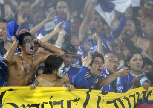 Fans of Millonarios celebrate after their team defeated Independiente Medellin in the final of the Colombian First Division soccer league in Bogota
