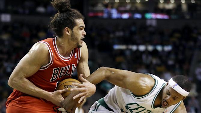 Chicago Bulls center Joakim Noah, left, and Boston Celtics forward Paul Pierce grapple for control of the ball during the second quarter of an NBA basketball game in Boston, Wednesday, Feb. 13, 2013. (AP Photo/Elise Amendola)