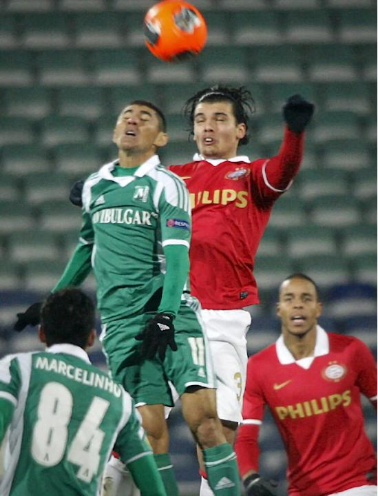 PSV Eindhoven's Karim Rekik, right, jumps for the ball along with Ludogorets' Juninho Quixad , left, during a Europa League group B soccer match between Ludogorets and PSV Eindhoven at the Vassil Levs